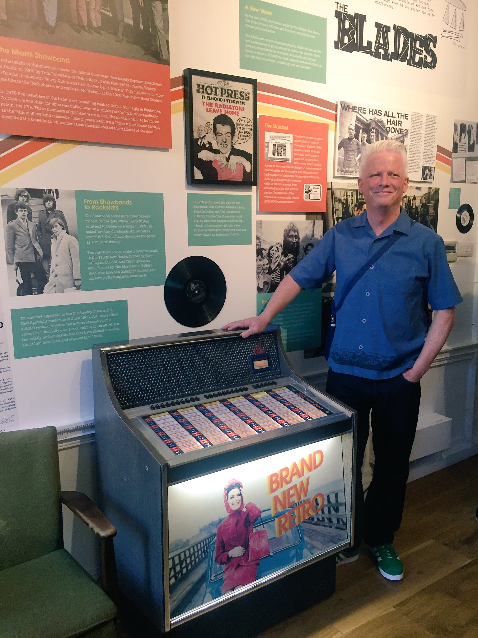 Brian McMahon, Brand New Retro, curator of the exhibition, at the fully functioning vinyl jukebox